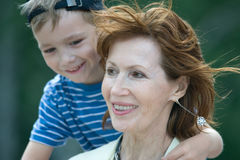 Smiling grandmother with grandson royalty free stock photo