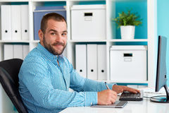 Smiling graphic designer in the office Stock Photos