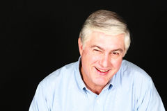 Smiling gray haired man Royalty Free Stock Image