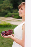Smiling greek woman with grapes in her hands Royalty Free Stock Photography