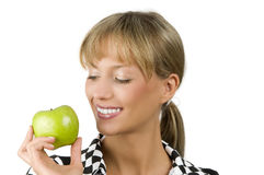 Smiling at green apple Royalty Free Stock Photography