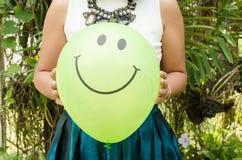 Smiling green balloon Stock Image