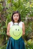 Smiling green balloon Stock Photo