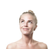 Smiling green eyed blond girl. Look up on isolated background Place For Logo Royalty Free Stock Image