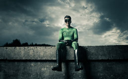 Smiling green superhero Stock Images