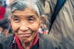 Smiling greyhaired woman in Bihar. Bohdgaya, Bihar - circa January 2012: Older woman with grey hair and nice smile poses during teachings in Bohdgaya, Bihar Royalty Free Stock Photos