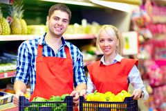 Smiling grocery staff working in supermarket Stock Photos