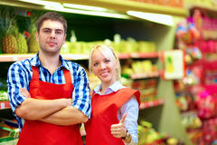 Smiling grocery staff working in supermarket Stock Photo