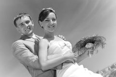 Smiling groom and bride against sky Royalty Free Stock Photo