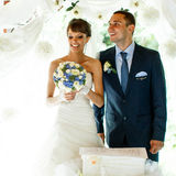 Smiling groom and bride on the  background white curtains Stock Photos