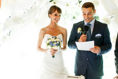 Smiling groom and bride on the  background white curtains Royalty Free Stock Photo