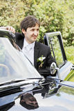 Smiling groom at car Royalty Free Stock Photo