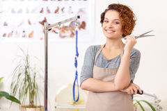 Smiling groomer with her work utensils Royalty Free Stock Image