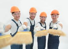 Smiling group of builders with a paint brush. Closeup.smiling group of builders with a paint brush.isolated on white royalty free stock photos