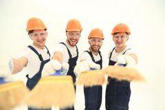 Smiling group of builders with a paint brush. Closeup.smiling group of builders with a paint brush.isolated on white stock images