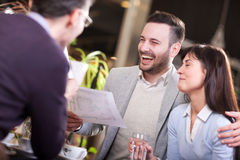 Smiling group of business people in coffee shop Stock Images