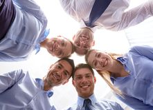 Smiling group of businesspeople standing in circle Royalty Free Stock Photo