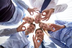 Smiling group of businesspeople standing in circle Royalty Free Stock Photos