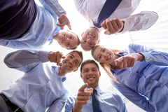 Smiling group of businesspeople standing in circle Royalty Free Stock Image