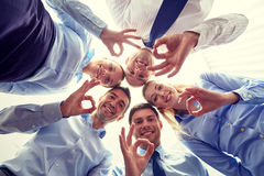 Smiling group of businesspeople standing in circle. Business, people and teamwork concept - smiling group of businesspeople standing in circle Stock Images