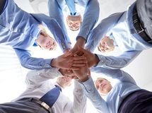 Smiling group of businesspeople standing in circle Stock Images