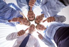 Smiling group of businesspeople standing in circle Royalty Free Stock Photography
