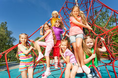 Smiling group of children sit on red ropes Royalty Free Stock Photos