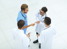 Smiling group of doctors discussing. View from the top.smiling group of doctors discussing .photo with copy space Royalty Free Stock Image