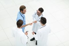 Smiling group of doctors discussing. View from the top.smiling group of doctors discussing .photo with copy space Stock Photography