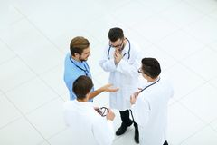 Smiling group of doctors discussing. View from the top.smiling group of doctors discussing .photo with copy space Royalty Free Stock Photos