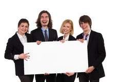 Smiling group of elegance people holding blank placard. Four happy elegance people holding banner. Three quarter length studio shot isolated on white Stock Photography