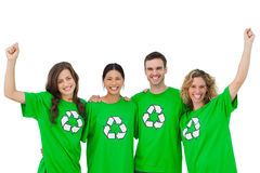 Smiling group of environmental activists raising arms Royalty Free Stock Photo