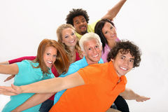 Smiling group of friends. Posing on the white background Royalty Free Stock Image