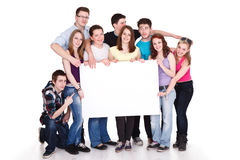 Smiling group of friends with banner Stock Photos