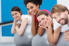 Smiling group of friends practising Pilates Royalty Free Stock Photography