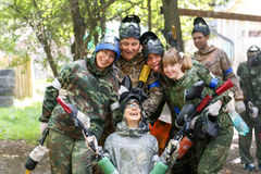 Smiling group of paintball players outdoors. In summer Stock Photos