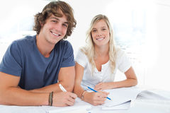 A smiling group of people as they both look at the camera Stock Photos