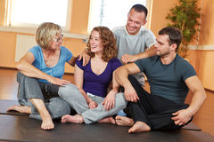 Smiling group talking in fitness. Smiling group with men and women talking in a fitness center Stock Photography