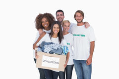 Smiling group of volunteers holding donation box Stock Images