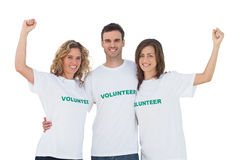 Smiling group of volunteers raising arms. On white background Royalty Free Stock Photo