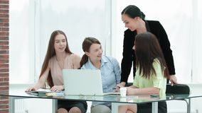 Smiling group of women behind a Desk in the office stock photos