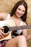 Smiling Guitar Girl Royalty Free Stock Photography