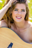 Smiling Guitar Woman Stock Photo