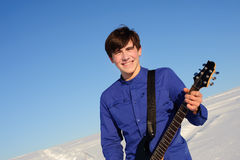 Smiling guitarist Royalty Free Stock Photography