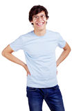 Smiling guy with arms akimbo Royalty Free Stock Photos