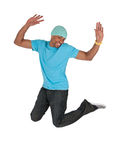Smiling guy in a blue t-shirt jumping for joy Royalty Free Stock Images