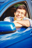Smiling guy in car Royalty Free Stock Photos