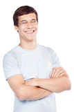 Smiling guy with crossed arms Stock Photos