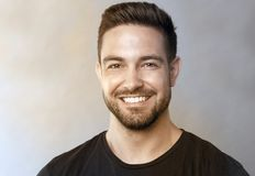 Smiling guy. Cute smiling guy, a horizontal portrait Stock Image