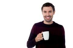 Smiling guy enjoying refreshing coffee Stock Photo
